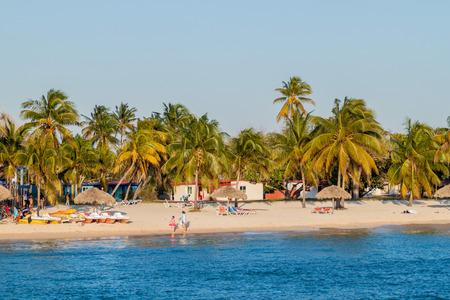 PLAYA GIRON, CUBA - FEB 14, 2016: People on a beach in Playa Giron village, Cuba. Editorial