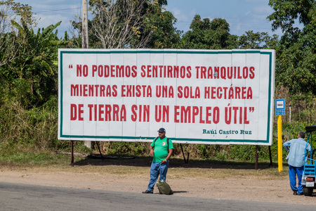 SANTA CLARA PROVINCE, CUBA - FEBRUARY 12, 2016: Cuban propaganda poster. It says: We must not rest while there is a single hectare of land not usefuly used.