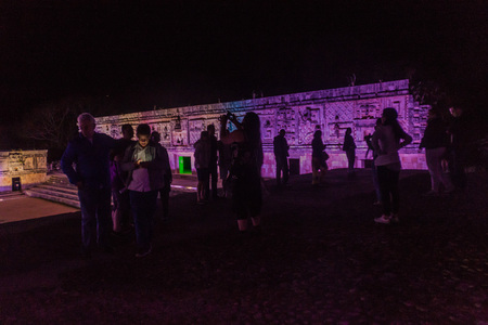 UXMAL, MEXICO - FEB 27, 2016: People watch a light show at Nuns Quadrangle (Cuadrangulo de las Monjas) building complex at the ruins of the ancient Mayan city Uxmal, Mexico