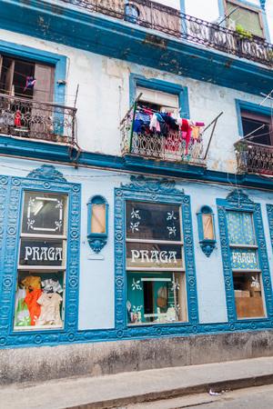 HAVANA, CUBA - FEBRUARY 20, 2016: Building with a shop called Praga in the center of Havana. Editorial