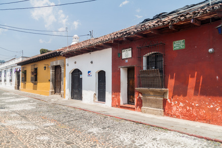 ANTIGUA, GUATEMALA - MARCH 27, 2016: View of a cobbled street in Antigua Guatemala city.
