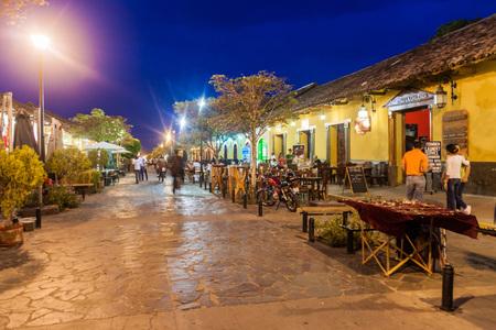 GRANADA, NICARAGUA - APRIL 27, 2016: Night view of pedestrian street Calle La Calzada in Granada, Nicaragua