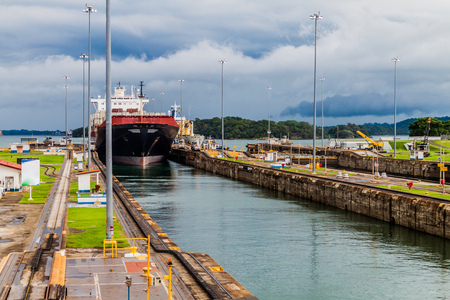 Container ship is  passing through Gatun Locks, part of Panama Canal