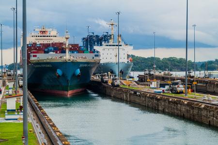 GATUN, PANAMA - MAY 29, 2016: Cargo ships are  passing through Gatun Locks, part of Panama Canal. Editorial