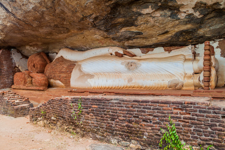 Statue of reclining Buddha under Pidurangala rock, Sri Lanka.