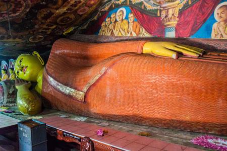 ALUVIHARE, SRI LANKA - JULY 20, 2016: Reclining Buddha at a cave at Aluvihare Rock Temple, Sri Lanka Editorial