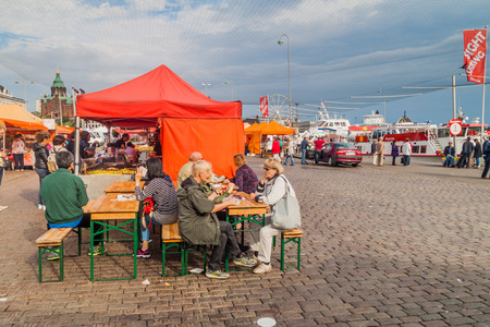 HELSINKI, FINLAND - AUGUST 25, 2016: View of food stalls at Kauppatori (Market Square) in Helsinki