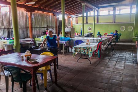GRANADA, NICARAGUA - APRIL 29, 2016: Small eatery in Mercado Municipal market in Granada, Nicaragua Editorial