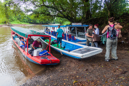 LA PAVONA, COSTA RICA - MAY 16, 2016: Passengers leave a boat on their way from Tortugueroon La Suerte river.
