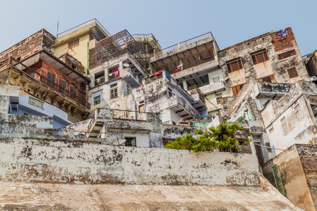 Buildings at a Ghat (riverfront steps) of sacred river Ganges in Varanasi, India
