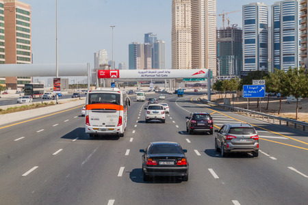 SHARJAH, UAE - MARCH 11, 2017: Traffic on the road connecting Dubai and Sharjah