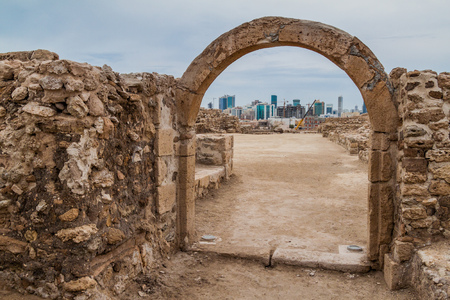 Ruins of Bahrain Fort (Qalat al-Bahrain) and Manama Skyline in Bahrain