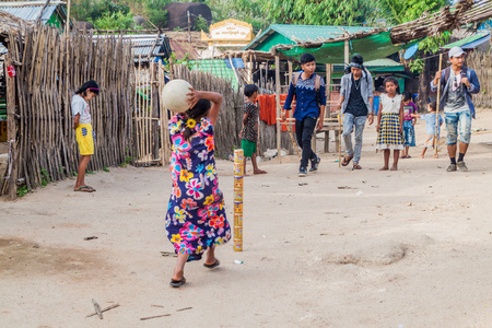 MT KYAIKTIYO, MYANMAR - DECEMBER 11, 2016: Children playing with a ball and cans near Mt Kyaiktiyo (Golden Rock), Myanmar