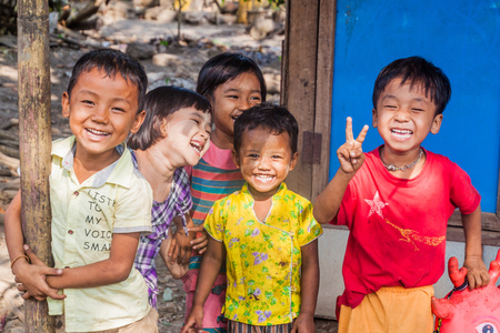 BAGO, MYANMAR - DECEMBER 10, 2016: Group of smiling local children in Bago town