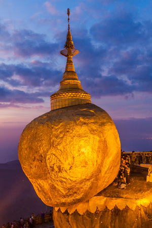 KYAIKTIYO, MYANMAR - DECEMBER 11, 2016: Golden Rock (Kyaiktiyo Pagoda) during sunset, Myanmar