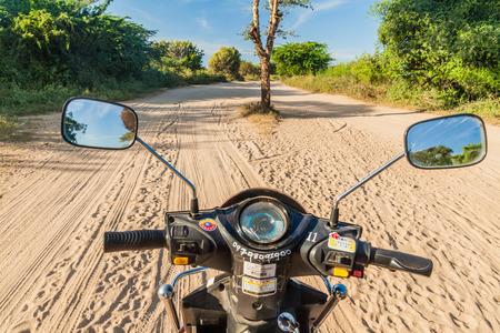 BAGAN, MYANMAR - DECEMBER 7, 2016: E-bike (electric scooter) on a sand trail in Bagan, Myanmar