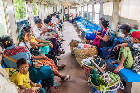 YANGON, MYANMAR - DECEMBER 16, 2016: Commuters in a carriage of a local train on Yangon circle line.