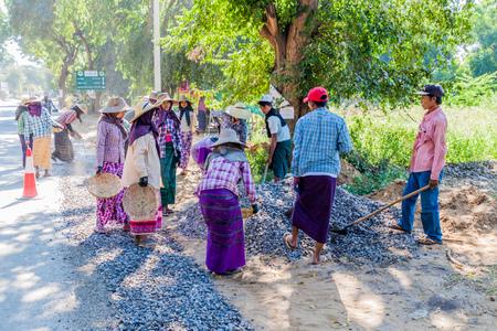 BAGAN, MYANMAR - DECEMBER 6, 2016: Local road workers building a macadam road in Bagan, Myanmar