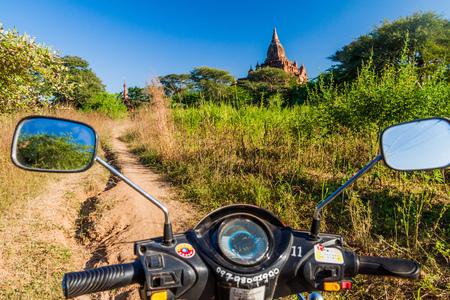 BAGAN, MYANMAR - DECEMBER 6, 2016: E-bike (electric scooter) on a dirt trail in Bagan, Myanmar Editorial