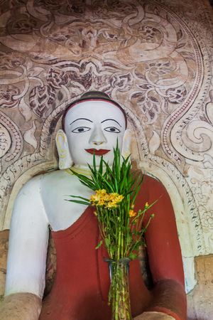 Buddha statue in Upali Thein temple in Bagan, Myanmar. Stock Photo