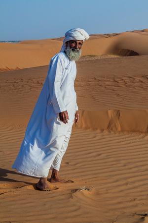 AL WASIL, OMAN - MARCH 5, 2017: Local bedouin in the sand dunes of Sharqiya (Wahiba) Sands near Al Wasil village.