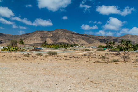 Small village at Wadi Dharbat near Salalah, Oman Фото со стока