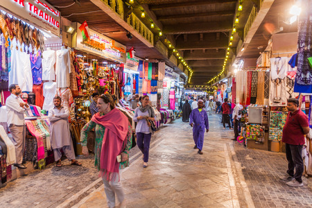 MUSCAT, OMAN - FEBRUARY 22, 2017: People shopping in Muttrah souq in Muscat, Oman