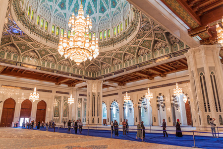 MUSCAT, OMAN - FEBRUARY 22, 2017: Tourists in Sultan Qaboos Grand Mosque in Muscat, Oman