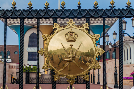 MUSCAT, OMAN - FEBRUARY 23, 2017: National emblem of Oman on the gate of Al Alam palace in Muscat, Oman Editorial