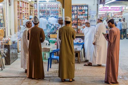 SALALAH, OMAN - FEBRUARY 24, 2017: Local men at a frankincense stall at Al Husn Souq in Salalah, Oman