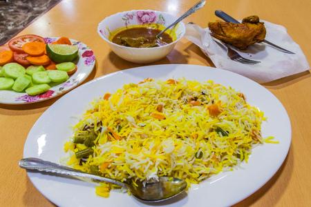 Biryani, curry and vegetables Foto de archivo