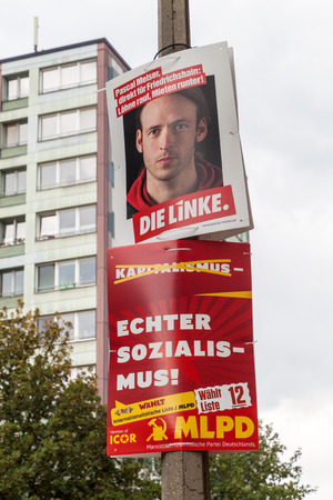 BERLIN, GERMANY - SEPTEMBER 1, 2017: Election posters of MLPD and Die Linke parties before 2017 Federal election.
