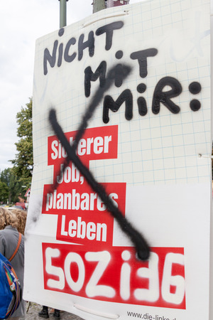 BERLIN, GERMANY - AUGUST 23, 2017: Vandalized election poster of Die Linke party before 2017 Federal election. 報道画像