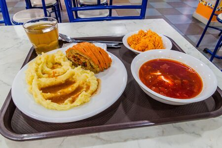 Food in an eatery in Almaty, Kazakhstan. Roulade with mashed potatoes, Borscht soup and carrot salad.