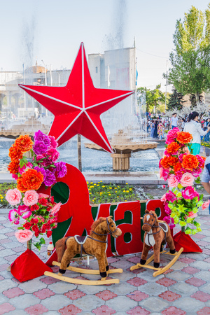 BISHKEK, KYRGYZSTAN - MAY 9, 2017: Red star and flowers for Victory Day (9 May) celebrations at Ala Too square in Bishkek, capital of Kyrgyzstan.