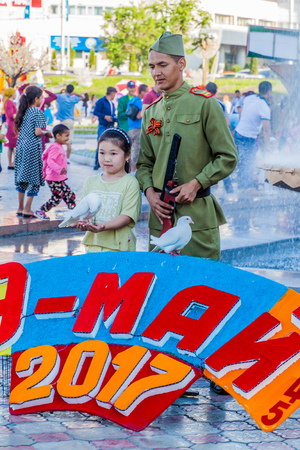 BISHKEK, KYRGYZSTAN - MAY 9, 2017: Soldier at Victory Day (9 May) celebrations at Ala Too square in Bishkek, capital of Kyrgyzstan.
