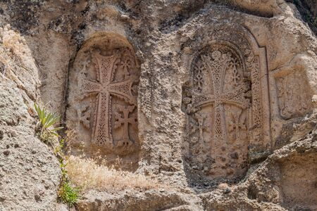 Crosses carved into a rock at Geghard monastery in Armenia Banco de Imagens