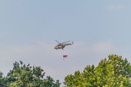 YEREVAN, ARMENIA - JULY 5, 2017: Helicopter carrying the national flag of Armenia during the celebrations of the Constitution Day and Day of State Symbols in Yerevan, capital of Armenia