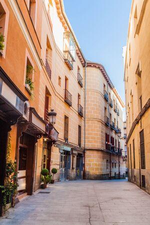 Narrow street in the center of Madrid, Spain Фото со стока