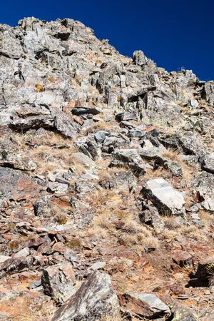 Rocky slope in Parc Natural Comunal de les Valls del Comapedrosa national park in Andorra