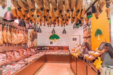 TOLEDO, SPAIN - OCTOBER 23, 2017: Interior of a meat shop full of hams in Toledo, Spain