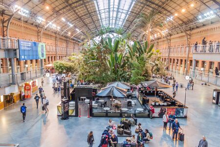 MADRID, SPAIN - OCTOBER 22, 2017:Tropical garden in the old Atocha train station in Madrid, Spain Banco de Imagens