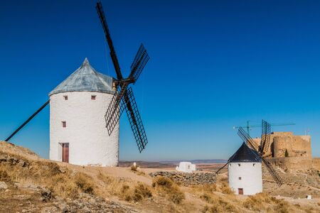 Windmills and a castle in Consuegra village, Spain