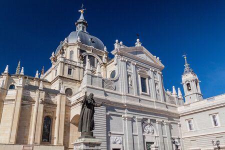 Catedral de la Almudena cathedral and John Paul II statue in Madrid, Spain Reklamní fotografie