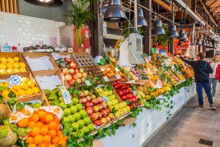 MADRID, SPAIN - OCTOBER 21, 2017: Fruit stall in Mercado de San Miguel market in Madrid.
