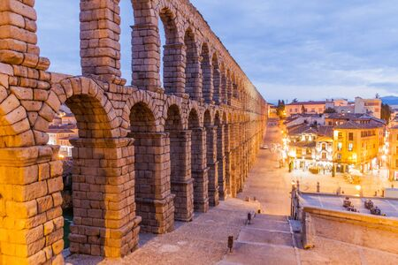 Evening view of Roman Aqueduct in Segovia, Spain Фото со стока