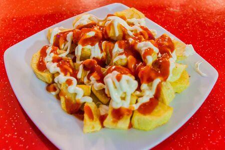 Patatas bravas, potatoes with a hot sauce, popular tapas dish in Spain