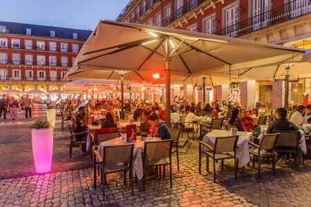 MADRID, SPAIN - OCTOBER 21, 2017: Street cafe at Plaza Mayor square in Madrid. Reklamní fotografie