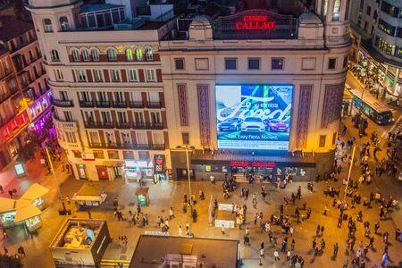 MADRID, SPAIN - OCTOBER 22, 2017: Evening at Plaza del Callao in Madrid Фото со стока