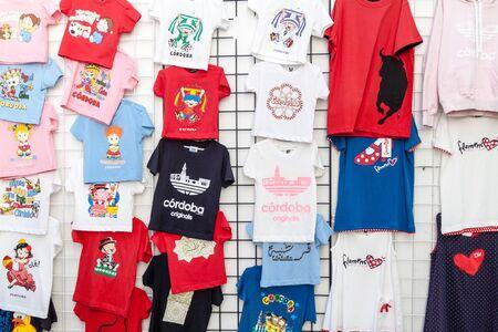 CORDOBA, SPAIN - NOVEMBER 5, 2017: T-shirts for sale in a souvenir store in Cordoba, Spain Reklamní fotografie
